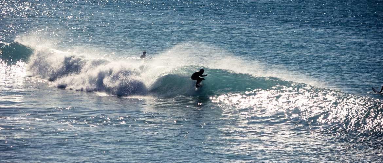 Camino Surfcamp Andalusien Surfer in small Tube in Los Canos de Meca DE