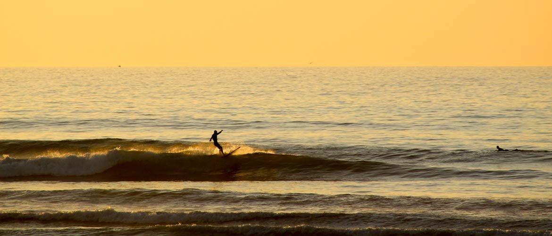 Camino Surfcamp Marokko Kris Sunset Longboard Tetrapods DE